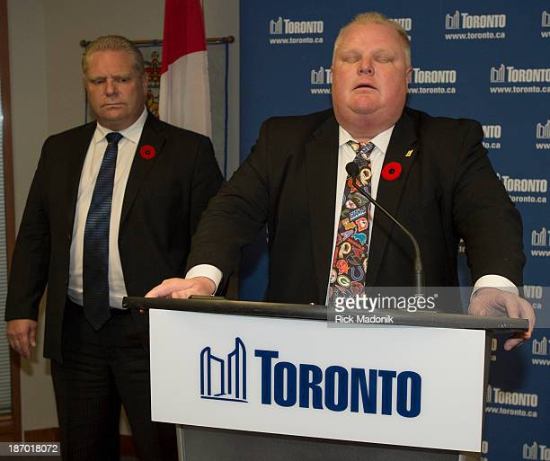 Toronto Mayor Rob Ford backed by brother Councillor Doug Ford on November 5 speaks to the media following this morning's admission of having smoked...