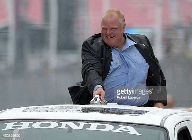 Toronto mayor Rob Ford goes around the track on a parade lap before race 1 of the Verizon IndyCar Series Honda Indy Toronto on the streets of Toronto...