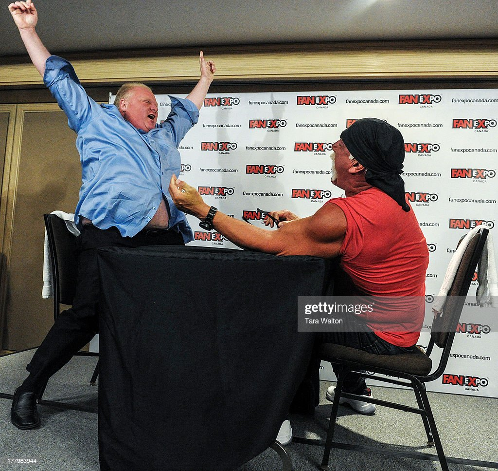 Toronto Mayor Rob Ford reacts after winning an arm-wrestle competition against former WWF wrestler Hulk Hogan Friday August 23, 2013 at Toronto's Fan Expo.