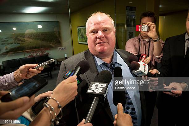 Toronto Mayor Rob Ford speaks to reporters outside his office about he massive predawn raids targeting guns and drugs Thursday focusing on the...