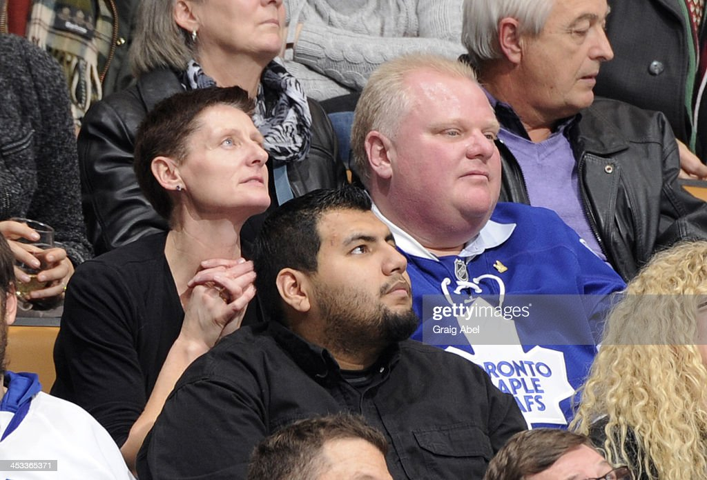 Toronto Mayor Rob Ford watches from the stands during NHL game action between the Toronto Maple Leafs and the San Jose Sharks December 3, 2013 at the Air Canada Centre in Toronto, Ontario, Canada.