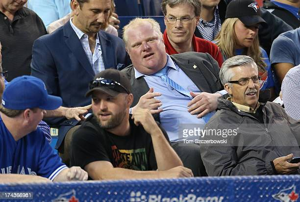 Toronto mayor Rob Ford watches the Toronto Blue Jays MLB game against the Los Angeles Dodgers on July 24 2013 at Rogers Centre in Toronto Ontario...