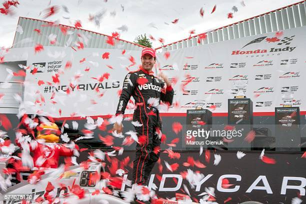JULY 17 Will Power of Team Penske emerges and from his car to a shower of confetti after winning the Honda Indy Toronto at Exhibition place Marcus...