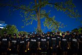 Toronto ON Canada JULY 20 Toronto police officers hold a memorial and candlelight vigil for US police officers killed in the line of duty At the...
