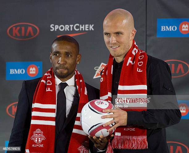 Toronto ON JANUARY 13 Newly signed Toronto FC striker Jermain Defoe left and midfielder Michael Bradley pose with the team colors during a press...