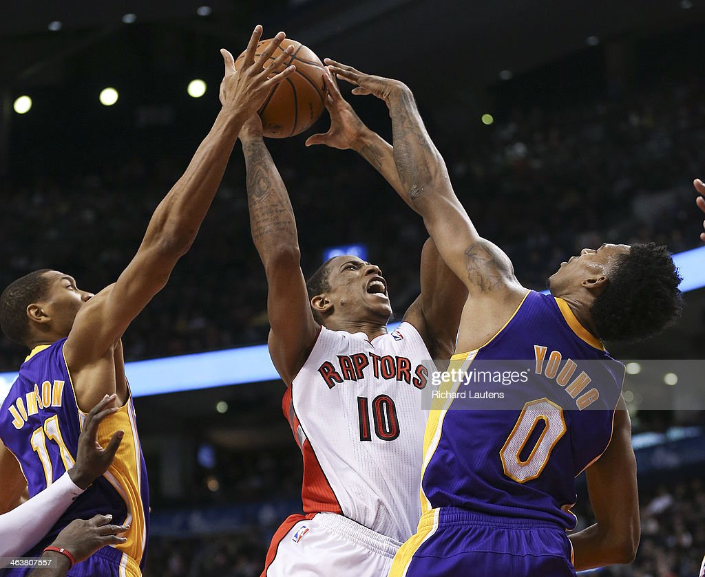 Toronto, ON - January 19 - In second half action, Toronto Raptors shooting guard DeMar DeRozan (10) runs into some tough defense on his way to the hoop courtesy of Los Angeles Lakers small forward Nick Young (0) and Los Angeles Lakers small forward Wesley Johnson (11). The Toronto Raptors lost to the LA Lakers 112-106 at the Air Canada Centre on Sunday afternoon. They blew a 17 point lead. January 19, 2014.
