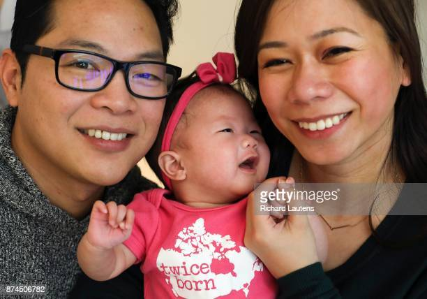 Toronto ON NOVEMBER 14 Dad baby and mom are all smiles following the press conference Doctors from Mount Sinai and Sick Kids hospital today joined...