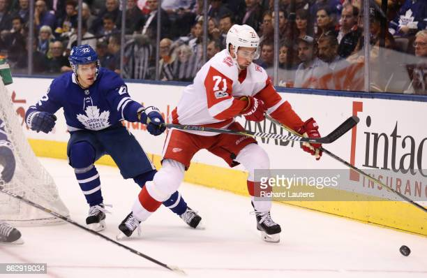 Toronto ON OCTOBER 18 In second period action Toronto Maple Leafs defenseman Nikita Zaitsev reaches around Detroit Red Wings center Dylan Larkin but...