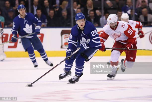 Toronto ON OCTOBER 18 In third period action Toronto Maple Leafs center William Nylander carries the puck up ice en route to scoring an empty net...