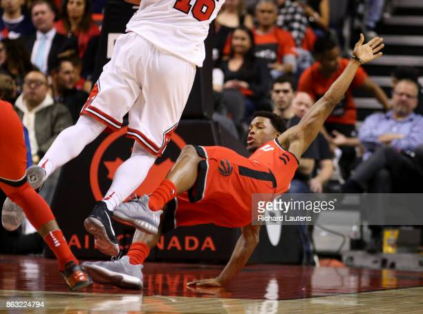 Toronto ON OCTOBER 19 In first half action Toronto Raptors guard Kyle Lowry gets dumped by Chicago Bulls guard Paul Zipser and was mad there was no...