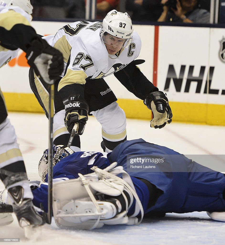 Toronto, ON - October 26 - In second period action, Pittsburgh Penguins center Sidney Crosby (87) reaches in but gets stopped by Toronto Maple Leafs goalie James Reimer (34). The Toronto Maple Leafs took on the Pittsburgh Penguins at the Air Canada Centre Saturday night. October 26, 2013
