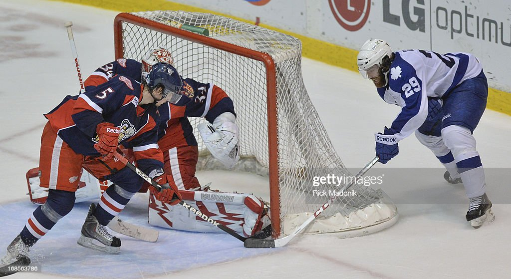 Toronto, Ontario - APRIL 10 - Marlies Jerry D'Amigo also succeeds in a wrap around but Grand Rapids defenceman Adam Almquist and netminder Petr Mrazek combine to stop the attempt during 3rd period action of Game 2 of AHL first round action between Toronto Marlies and Gran Rapid Griffins on Saturday, May 11, 2013 at Richoh Coliseum, in Toronto. Marlies won 4-2 evening up the series 1-1 as they head back to Grand Rapids for games 3, 4 and 5.