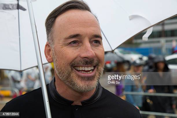 Toronto Ontario JUNE 28 2015 Filmmaker and producer David Furnish smiles prior to the start of Pride 2015 parade The Scarborough is married to Elton...