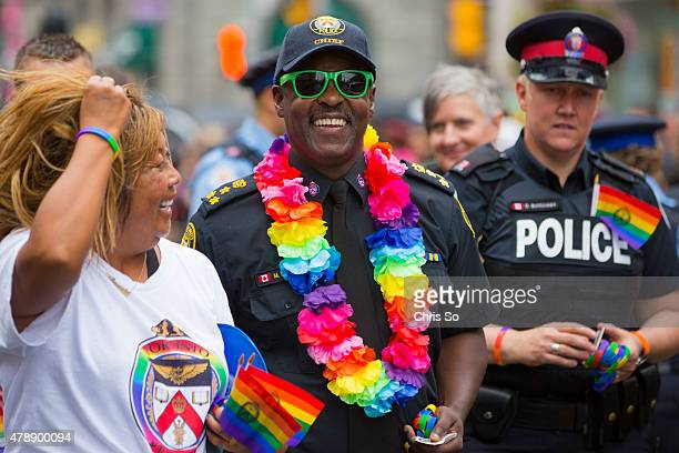 Toronto Ontario JUNE 28 2015 Toronto Police Chief Mark Saunders takes part in the parade for Pride Toronto 2015 JUNE 28 2015