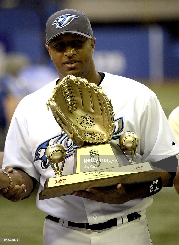 Toronto outfielder Vernon Wells receives his 2004 Gold Glove Award prior to the game The Toronto Blue Jays defeated the St Louis Cardinals 52 at the...