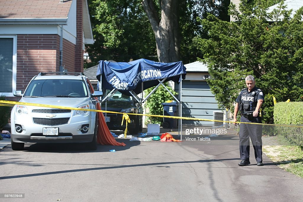 TORONTO ON AUGUST 26 Toronto Police continue to secure the scene where the triple murder happened at 10 Lawndale Rd in Scarborough