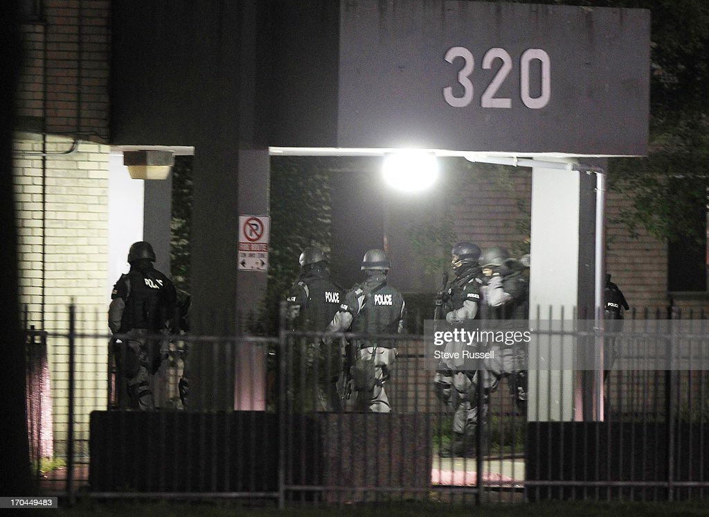 Toronto police raid buildings at 320, 330 and 340 Dixon Road, concentrating on 320. Police in tactical gear were working with the Guns and Gangs unit. The focus is on the Toronto neighbourhood thats ground zero for the Mayor Rob Ford crack video scandal.