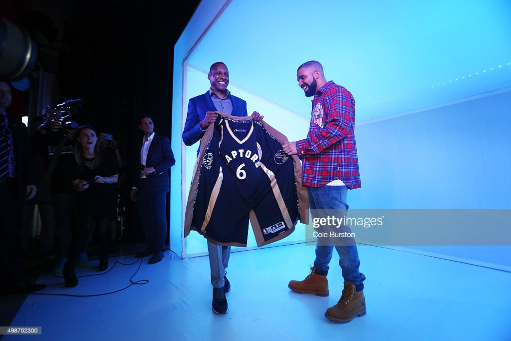 TORONTO, ON - NOVEMBER 25 - Toronto Rapper Drake poses with a Raptors jersey lined coat and Toronto Raptors General Manager Masai Ujiri in a 'Hotline Bling' installation at the Air Canada Centre in Toronto on November 25, 2015, prior to a Toronto Raptors vs. Cleveland Cavaliers NBA game.