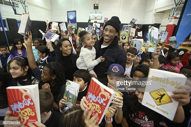 TORONTO ON JANUARY 27 Toronto Raptor Demar DeRozan with fiance Kiara Morrison and daughter Diar 2 years old poses for pictures with students in ten...