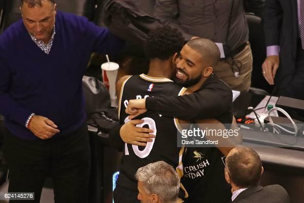Toronto Raptors Ambassador and Performer Drake hugs DeMar DeRozan of the Toronto Raptors after the game against the Golden State Warriors at Air...