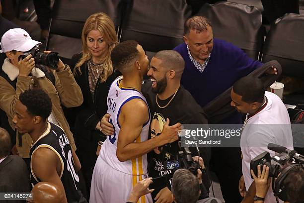Toronto Raptors Ambassador and Performer Drake hugs Stephen Curry of the Golden State Warriors after the game against the Toronto Raptors at Air...