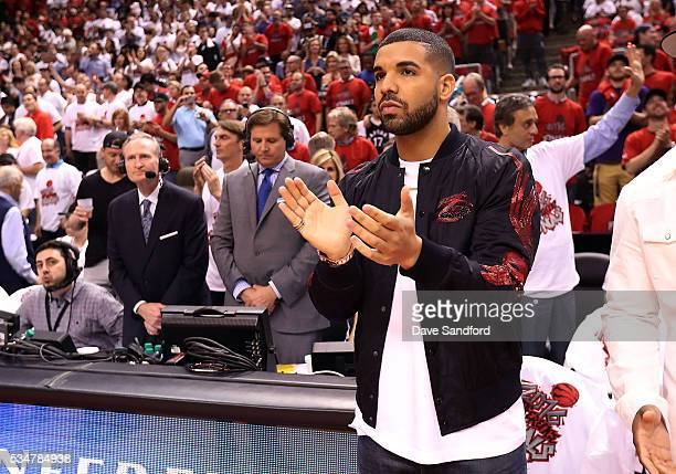 Toronto Raptors Ambassador Musician Drake cheers prior to the Toronto Raptors facing the Cleveland Cavaliers in Game Six of the Eastern Conference...