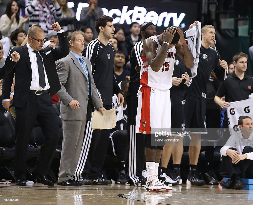 Toronto Raptors Amir Johnson hangs his head after just missing the three to win over the Brooklyn Nets in front of Nets bench in Toronto in the second half of the nail biter. November 26, 2013.