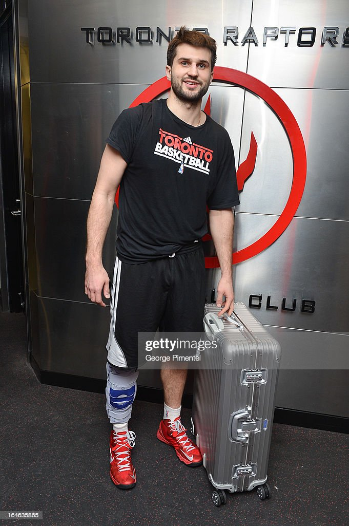 Toronto Raptors basketball player Linas Kleiza arrives at Slam Dunk For Rimowa And The Raptors at Air Canada Centre on March 14 2013 in Toronto Canada