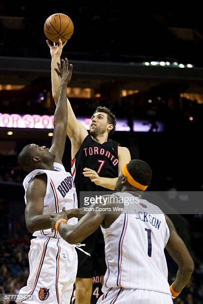 Toronto Raptors center Andrea Bargnani throws up a shot against Charlotte Bobcats center Nazr Mohammed and guard Stephen Jackson during an NBA...