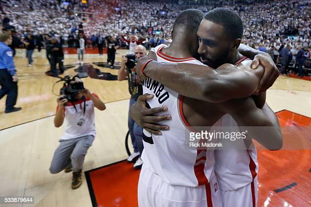 Toronto Raptors center Bismack Biyombo is hugged by Toronto Raptors forward Patrick Patterson after the final buzzer Toronto Raptors vs Cleveland...