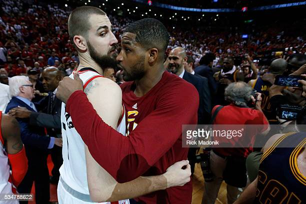 Toronto Raptors center Jonas Valanciunas and Cleveland Cavaliers center Tristan Thompson hug following the series finale Toronto Raptors vs Cleveland...