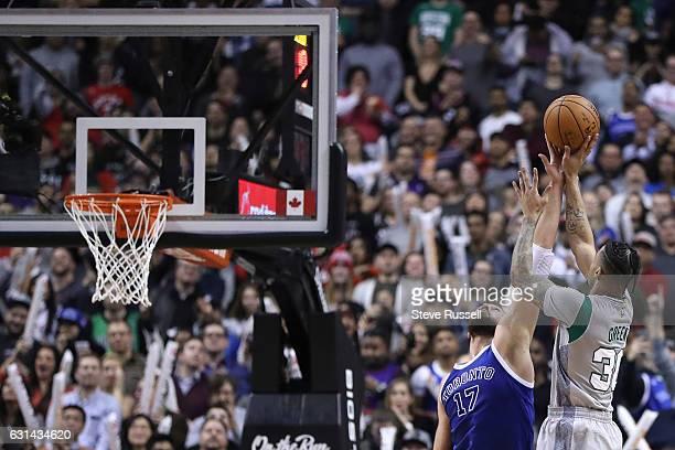 TORONTO ON JANUARY 10 Toronto Raptors center Jonas Valanciunas blocks Boston Celtics forward Gerald Green late in the game as the Toronto Raptors...