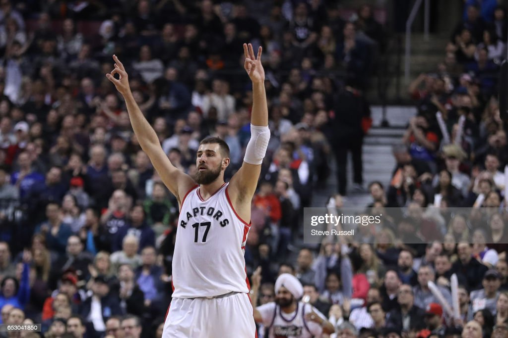 TORONTO, ON- MARCH 13 - Toronto Raptors center Jonas Valanciunas (17) celebrates a Norman Powell three pointer as the Toronto Raptors play the Dallas Mavericks at the Air Canada Centre in Toronto. March 13, 2017.