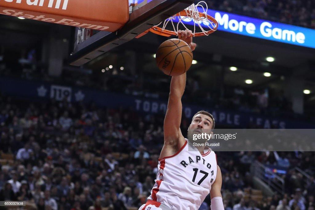 TORONTO, ON- MARCH 13 - Toronto Raptors center Jonas Valanciunas (17) dunks as the Toronto Raptors play the Dallas Mavericks at the Air Canada Centre in Toronto. March 13, 2017.