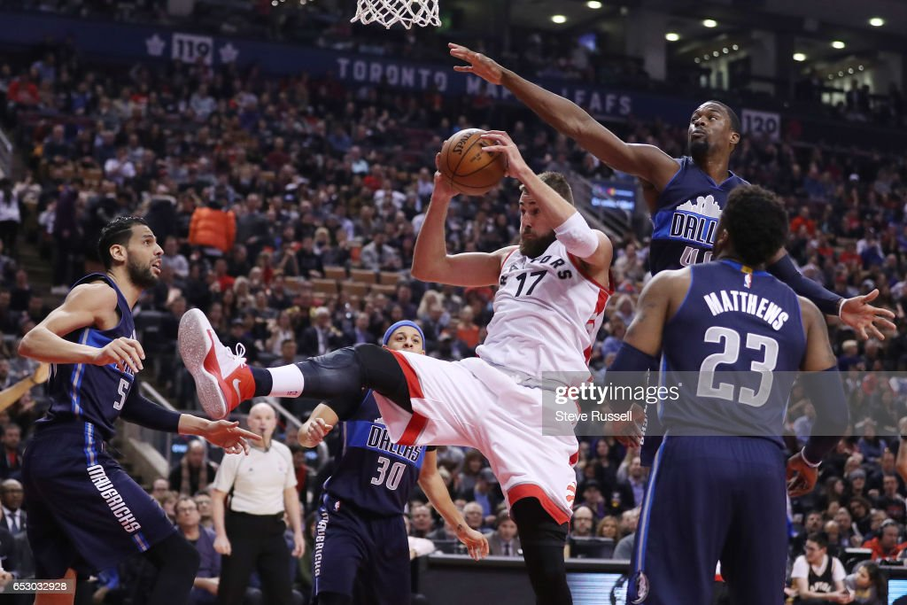 TORONTO, ON- MARCH 13 - Toronto Raptors center Jonas Valanciunas (17) hauls in a rebound as the Toronto Raptors play the Dallas Mavericks at the Air Canada Centre in Toronto. March 13, 2017.
