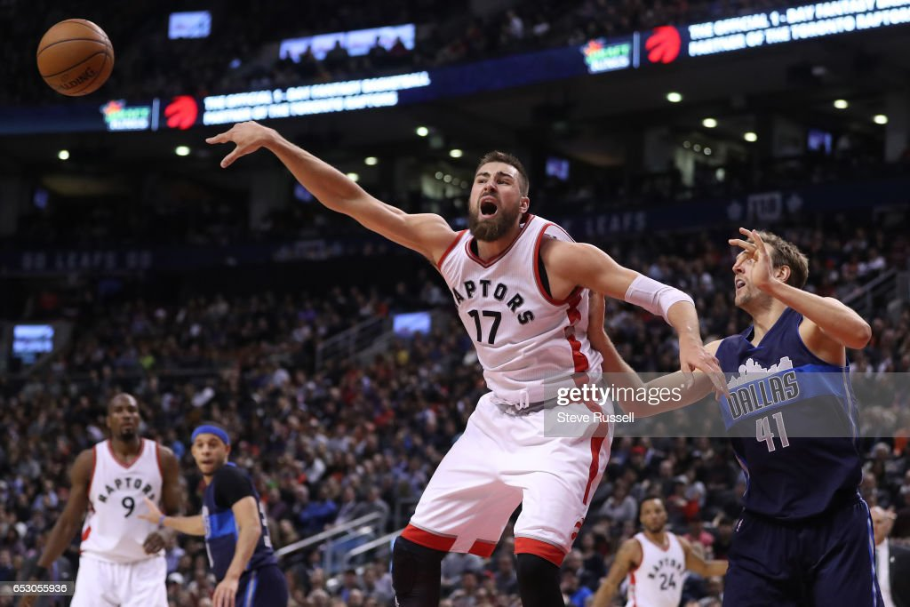 TORONTO, ON- MARCH 13 - Toronto Raptors center Jonas Valanciunas (17) kicks the ball back out as \t41#3\ guards him as the Toronto Raptors beat the Dallas Mavericks 100-78 at the Air Canada Centre in Toronto. March 13, 2017.