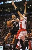 TORONTO ON DECEMBER 10 Toronto Raptors center Jonas Valanciunas rejects San Antonio Spurs point guard Tony Parker under the basket as the San Antonio...