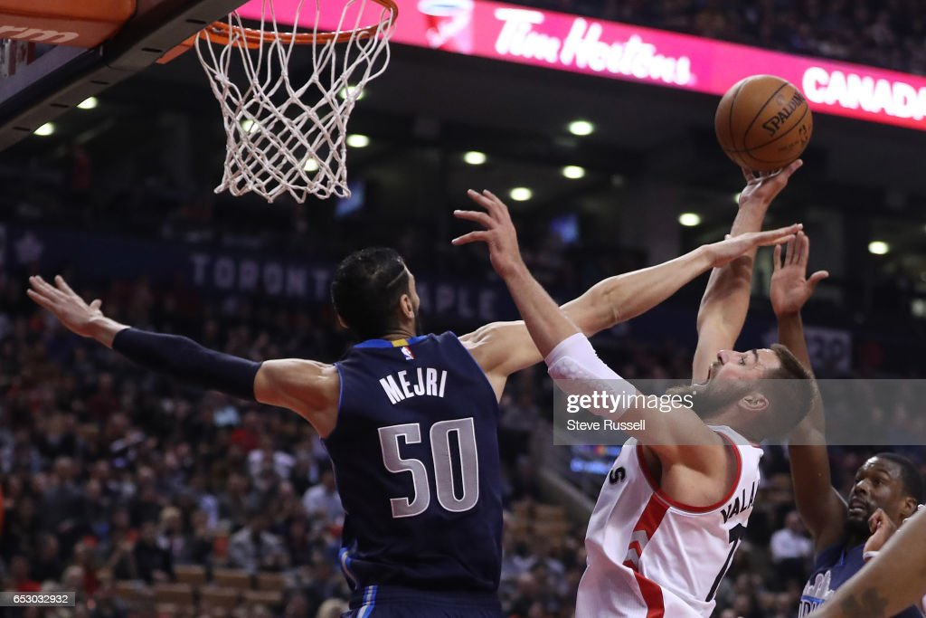 TORONTO, ON- MARCH 13 - Toronto Raptors center Jonas Valanciunas (17) tries to get a shot past Dallas Mavericks forward Harrison Barnes (40) as the Toronto Raptors play the Dallas Mavericks at the Air Canada Centre in Toronto. March 13, 2017.