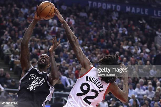 TORONTO ON JANUARY 24 Toronto Raptors center Lucas Nogueira gets his hand on the ball as San Antonio Spurs center Dewayne Dedmon shoots as the...