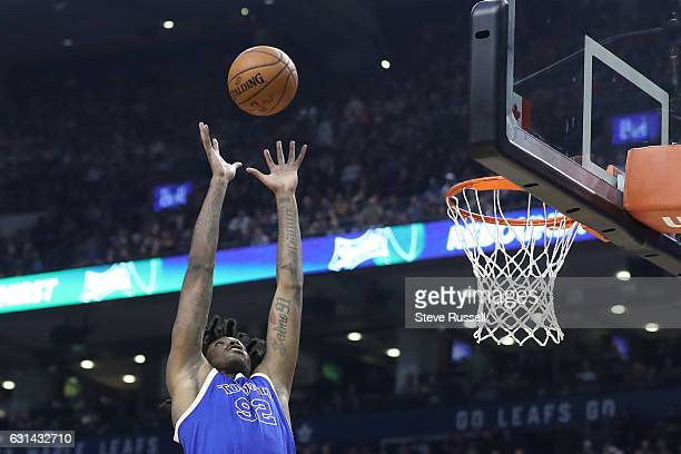 TORONTO ON JANUARY 10 Toronto Raptors center Lucas Nogueira leaps for an alley oop as the Toronto Raptors wearing their throw back Toronto Huskies...