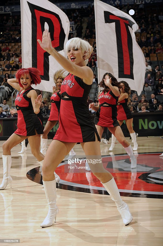 Toronto Raptors Dance Team get the crowd pumped up against the Charlotte Bobcats during the game on January 11, 2013 at the Air Canada Centre in Toronto, Ontario, Canada.
