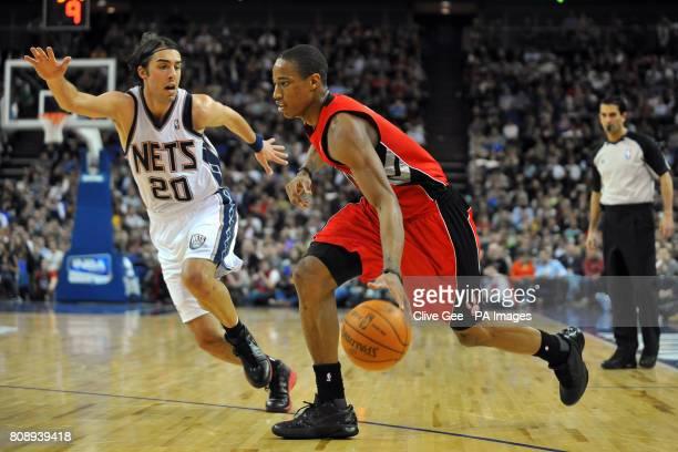 Toronto Raptors' DeMar DeRozan and New Jersey Nets' Sasha Vujacic in action