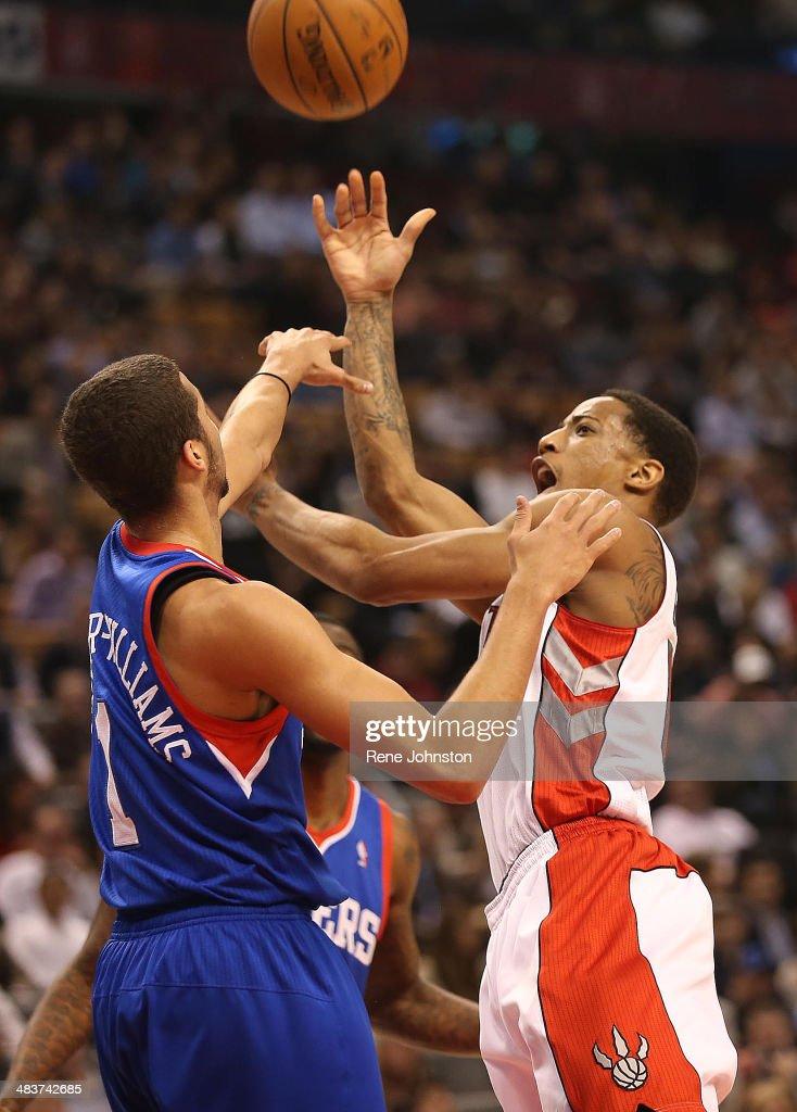TORONTO, ON -APRIL 9 - Toronto Raptors DeMar DeRozan draws the foul on Michael Carter Williams of the Philadelphia 76ers in the first half. Toronto, April 9, 2014.