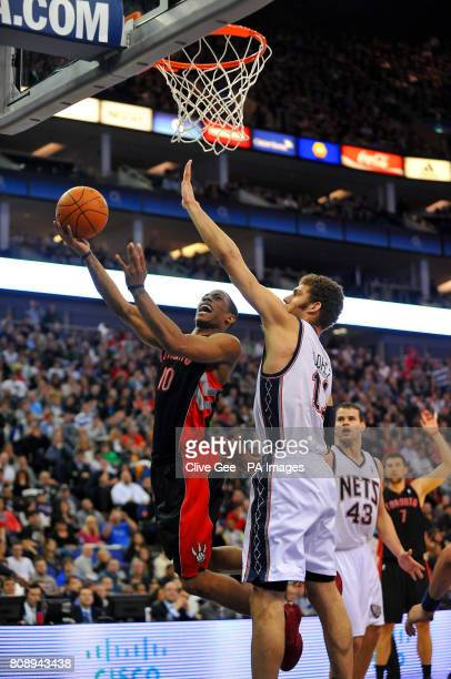 Toronto Raptors' DeMar DeRozan drives to the net past New Jerseys Nets' Brook Lopez during the NBA match at the O2 Arena London
