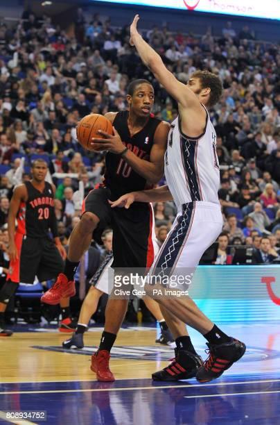 Toronto Raptors' DeMar DeRozan tries to pass New Jerseys Nets' Brook Lopez during the NBA regular season match at the O2 Arena London