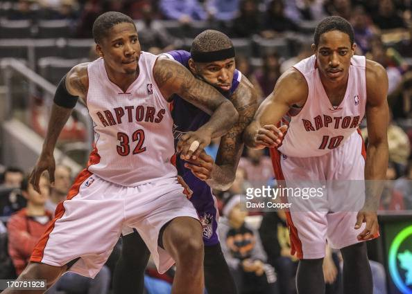 Toronto Raptors Ed Davis and DeMar DeRozan box out Kings DeMarcus Cousins during the 4th quarter of the game as the Toronto Raptors lost 10596 to the...