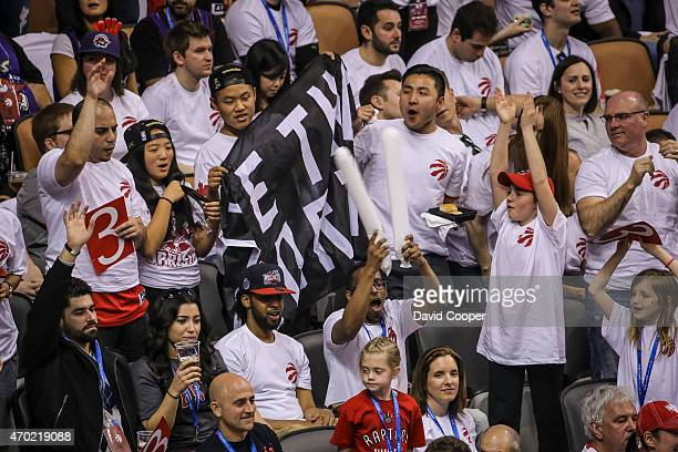 TORONTO ON APRIL 18 Toronto Raptors fans cheer for their team during a break in the action in the first half of the game between the Toronto Raptors...