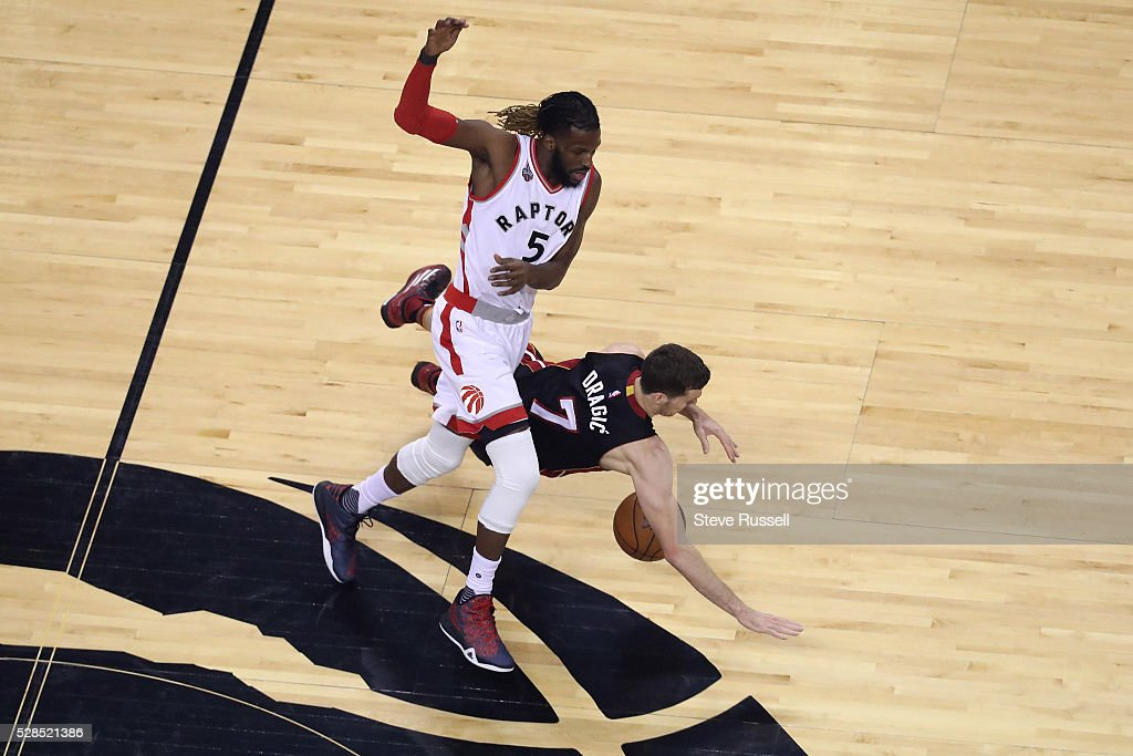 Toronto Raptors forward DeMarre Carroll is fouled by Goran Dragic as the Toronto Raptors play the Miami Heat in game two of their Eastern Conference Semifinal at the Air Canada Centre in Toronto. May 5, 2016.
