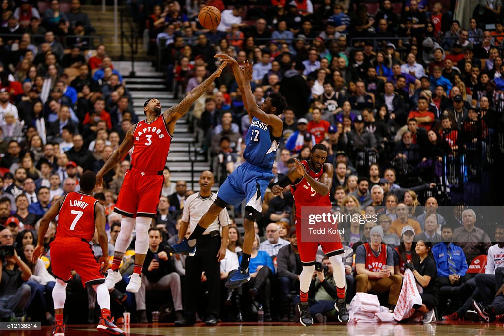 Toronto Raptors forward James Johnson tries to block the shot of Minnesota Timberwolves guard Andrew Wiggins in the second half of their NBA...