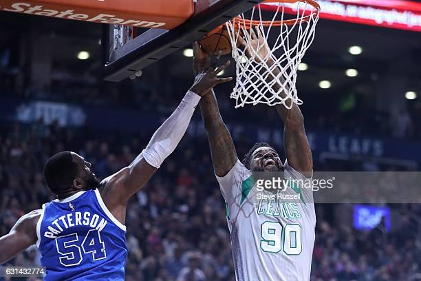 TORONTO ON JANUARY 10 Toronto Raptors forward Patrick Patterson gets enough of the ball to deny Boston Celtics forward Amir Johnson as the Toronto...